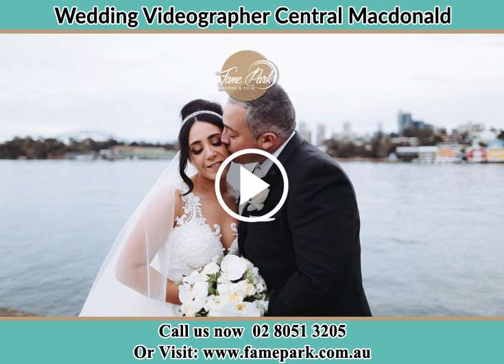 Bride and Groom kissed at the shore Central Macdonald NSW 2775