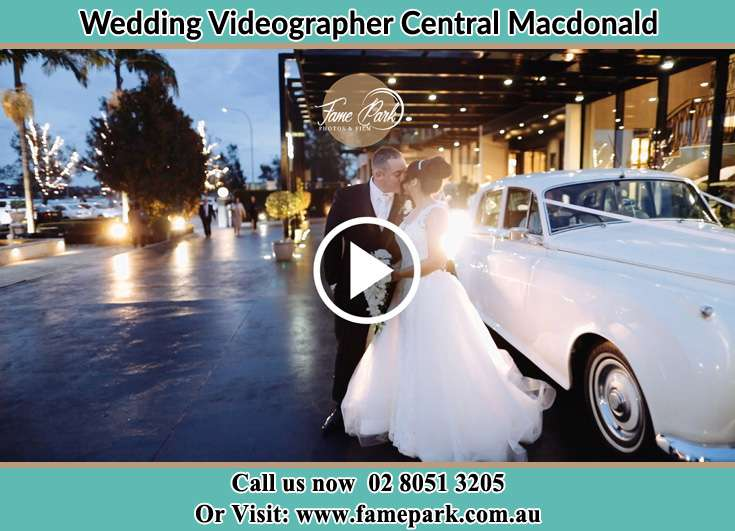 Bride and Groom kissed beside the bridal car Central Macdonald NSW 2775