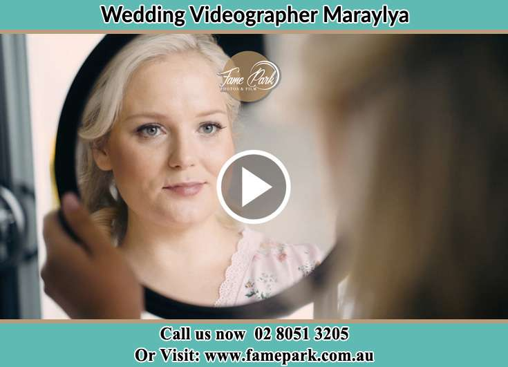 Bride looking at the mirror Maraylya NSW 2765