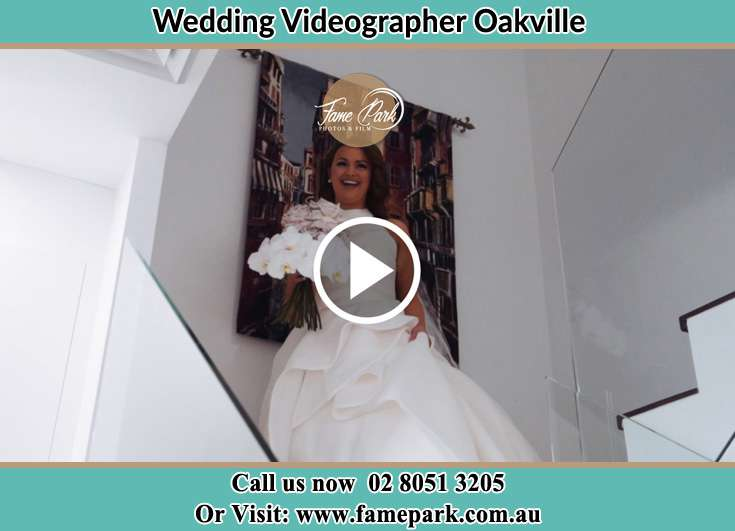 Bride walking down the staircase Oakville NSW 2765