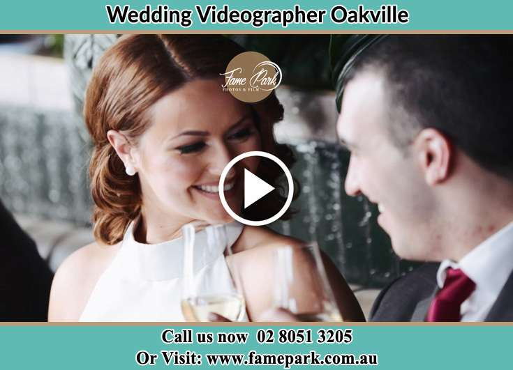 Bride and Groom looking at each other while making a toast Oakville NSW 2765